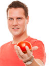 Happy man in red shirt holding apple diet health care healthy nutrition concept handsome holds natural fruit vitamin isolated on Stock Photos