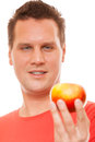 Happy man in red shirt holding apple diet health care healthy nutrition concept handsome holds natural fruit vitamin isolated on Stock Images
