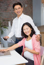 Happy man showing tablet to his pregnant wife men at home Royalty Free Stock Images