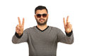 Happy man showing victory hands with sunglasses sign gesture isolated on white background Stock Photo