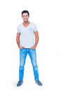 Happy man smiling at camera with hands in pocket Royalty Free Stock Photo