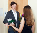 Happy man smiling and give bunch of flowers men to his wife at home door Stock Photography