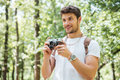 Happy man taking pictures with old photo camera in forest Royalty Free Stock Photo