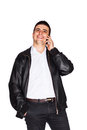 Happy man talking on cell phone handsome young laughing while having a conversation his mobile isolated white Royalty Free Stock Photos