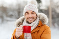 Happy man with tea cup outdoors in winter Royalty Free Stock Photo