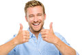 Happy man thumbs up sign full length portrait on white background showing Stock Images