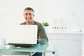 Happy man using his laptop at desk Royalty Free Stock Photo