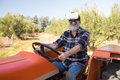Happy man using virtual reality headset in tractor Royalty Free Stock Photo