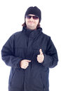 Happy man in winter clothes showing thumb up isolated on white background Royalty Free Stock Photos