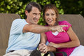Happy Man Woman Couple Holding Hands and Pointing Royalty Free Stock Image