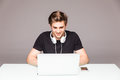 Happy man working in front of laptop on office table Royalty Free Stock Photo