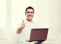 Happy man working with laptop computer at home Royalty Free Stock Photo