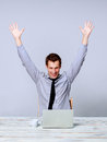 Happy man working on laptop in the office Royalty Free Stock Photo