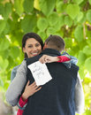 Happy marriage proposal outdoor photo of young couple embracing after Royalty Free Stock Image