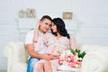 Happy married couple awaiting baby. Gentle pregnancy. Royalty Free Stock Photo
