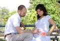 Happy married couple sitting on a bench Royalty Free Stock Photos