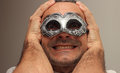 Happy masquerade smiling man at the with silver mask Royalty Free Stock Images