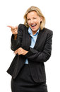 Happy mature business woman pointing laughing being silly isolat Stock Photos