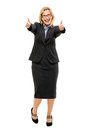 Happy mature business woman thumbs up isolated on white backgrou showing full length Stock Image