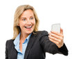 Happy mature business woman video messaging mobile phone isolate using Royalty Free Stock Photos