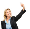 Happy mature business woman video messaging mobile phone isolate using Royalty Free Stock Image