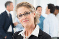 Happy mature businesswoman closeup of in front of colleague Stock Images