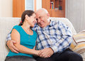 Happy mature couple on couch together Royalty Free Stock Images