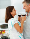 Happy mature couple drinking wine together at home Royalty Free Stock Photo