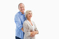 Happy mature couple embracing each other on white background Stock Image