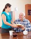 Happy mature couple having breakfast tea in morning Royalty Free Stock Photo