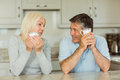 Happy mature couple having coffee together at home in the kitchen Royalty Free Stock Image