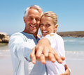 Happy mature couple having fun at the beach Stock Photos