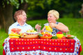 Happy mature couple having lunch outdoors Stock Photography