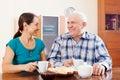 Happy mature couple having tea at home Royalty Free Stock Photo