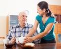 Happy mature couple having tea at home interior Stock Photo