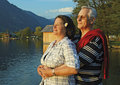 Happy mature couple by lake Royalty Free Stock Images