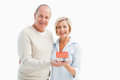 Happy mature couple with model house Royalty Free Stock Photo