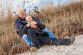 Happy mature couple relaxing baltic sea dunes in autumn Royalty Free Stock Images