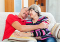 Happy mature couple relaxing on couch t Royalty Free Stock Photography