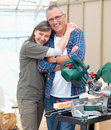Happy mature couple renovating their home Royalty Free Stock Photography