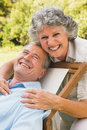Happy mature couple smiling at camera in park Royalty Free Stock Photography