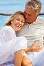 Happy mature couple smiling and embracing outdoors Royalty Free Stock Photos