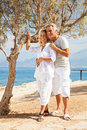 Happy mature couple smiling and embracing outdoors Royalty Free Stock Photo