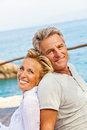 Happy mature couple smiling and embracing outdoors Stock Image