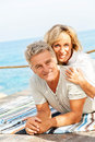 Happy mature couple smiling and embracing outdoors Stock Photo