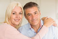Happy mature couple smiling together at home in the kitchen Royalty Free Stock Photos