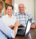 Happy mature couple  with social worker Royalty Free Stock Photo