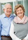 Happy mature couple standing together and smiling Stock Photo