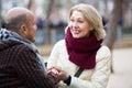 Happy mature couple talking outdoors portrait of smiling having joyful conversation Stock Image