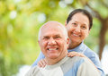 Happy mature couple together in autumn park Royalty Free Stock Photo